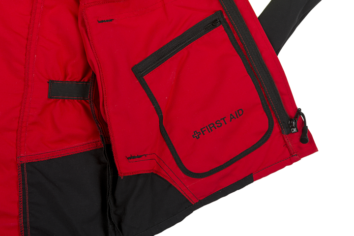 1 patched First Aid pocket with zip closure on the left side