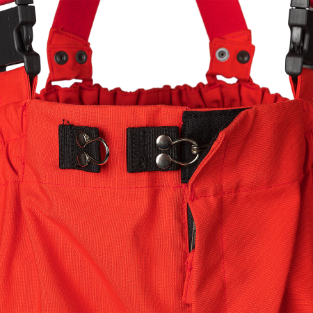 Front fly with zip closure under flap + touch and close fastening + fixed by an adjustable hook and 2 eyelets