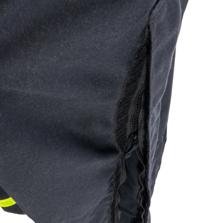 Zipper under flap with touch and close fastening, at the side seam of the legs