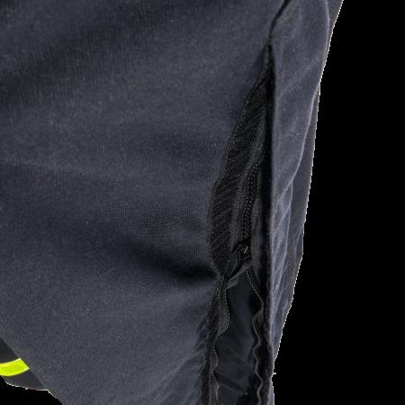 Ouverture latérale à glissière sous rabat avec fermeture auto-agrippante, à la couture de côté des jambes